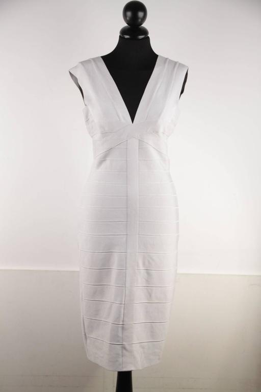 - Bandage Halter v-neck dress light pearl color from Herve Leger  - Imported  - Sleeveless style  - Rear zipper with hook-and-eye closure.  - Form-fitting dress  - V-neck & V-back  - Rayon, Nylon & Spandex  Logos / Tags: 'HERVE LEGER'