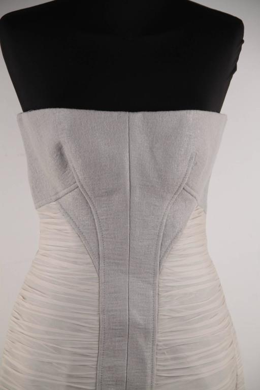 - Versace Wool Bustier Dress from the Fall 2007 collection - Dove grey strapless mini dress - Built in bustier with sweatheart neckline - Side chiffon ruching - Zipper runs all the way down the back - Composition: 41% wool, 20% linen, 20%,