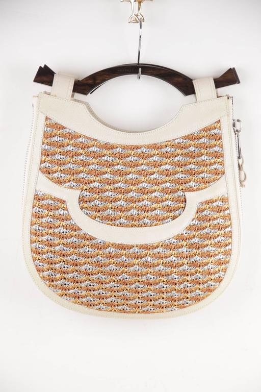 - Structured tote handbag by PROENZA SCHOULER  - Crafted in multicolored woven cord with beige leather trim  - Top carry wood handle  - Open top  - 1 Front open pocket  - Expandable bag thanks to a side zip  - Black fabric lining  - 1