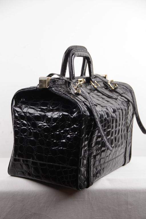 - Crafted in black patent leather