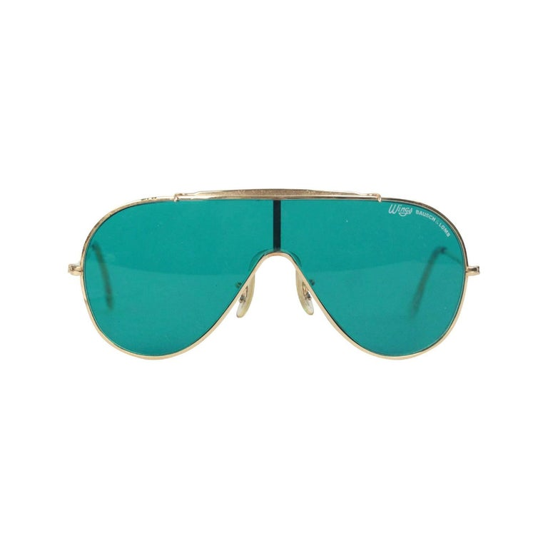 dd259b84be RAY-BAN Bausch and Lomb Vintage Gold metal WINGS One Piece Shield SUNGLASSES  For Sale at 1stdibs