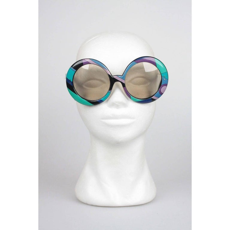 Fashion Statement Iconic EMILIO PUCCI Sunglasses,  Made in France - Oversized frame from early 70s - Mod style, large round shaped frame with light brown lens - Fantastic Classic Pucci Graphics in blue and green shades Measurements: - TEMPLE MAX.