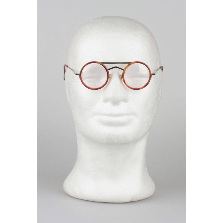 - Supercool round frames by Gianni Versace in the 1980s Mod.620 - col. 945 - 42/22 -  Gold metal 6 tortoise brawn acetate  frame  - Clear DEMO lenses  - Cool double bridge structure and tortoise temple tips. - Minimalist and smart
