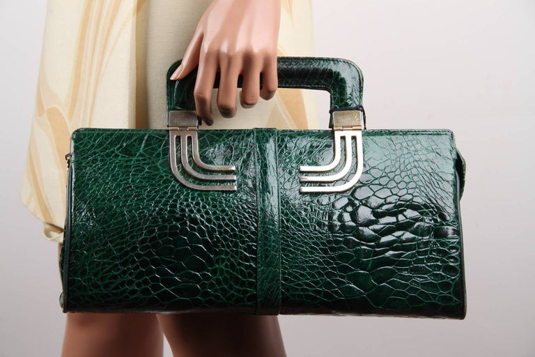 - Beautiful green color  - Gold metal hardware  - Upper zipper closure  - Green lining  - 1 side zip pocket & 2 side open pockets  - It will come with its matching wallet/coin purse  Condition rate & details (please read our condition chart below):