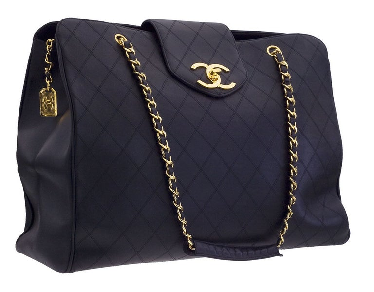 Chanel black quilted overnighter bag with gold chain. It has 3 compartments.