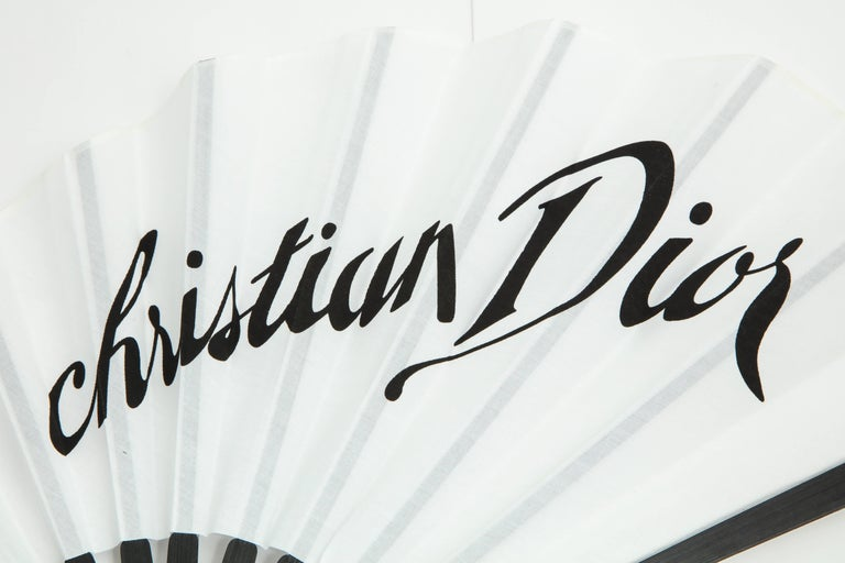 Extremely rare Christian Dior by John Galliano fan in black and white.  Made of fabric.