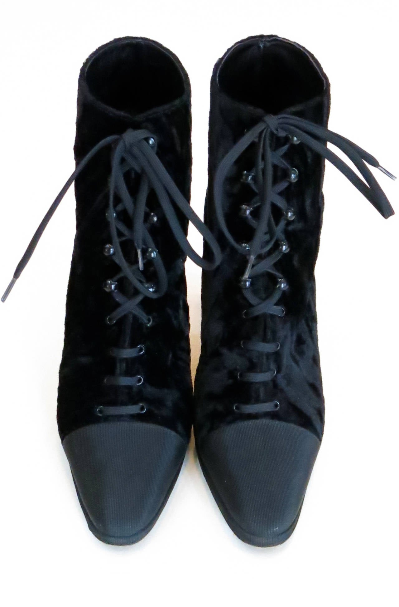 """1980s Anne Klein black velvet Victorian-style ankle boots with leather lining and sole. Label reads """"Anne Klein Couture"""" and sole reads """"Made in Italy"""". Size 6 1/2 M.  *Please contact dealer prior to purchase for white glove shipping options."""