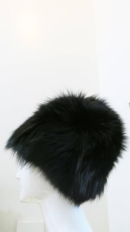 Fully lined black fox fur hats from Saks Fifth Avenue circa the 1970's. Beautiful, soft, and in impeccable condition. This hat is definitely on the larger side, so please pay attention to the measurements included below. Lining and stitching on the