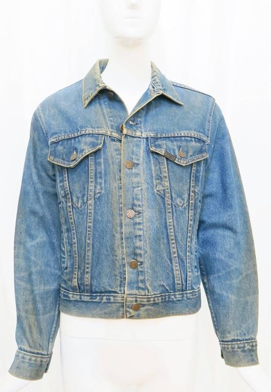 """This denim jacket was designed for Sears Roebuck & Co., bearing iconography  likely from the rock band Led Zeppelin's 1972 album and 1973 tour, """"Ascension in the Wane"""". An exciting piece of clothing and music history in one. Made in the"""