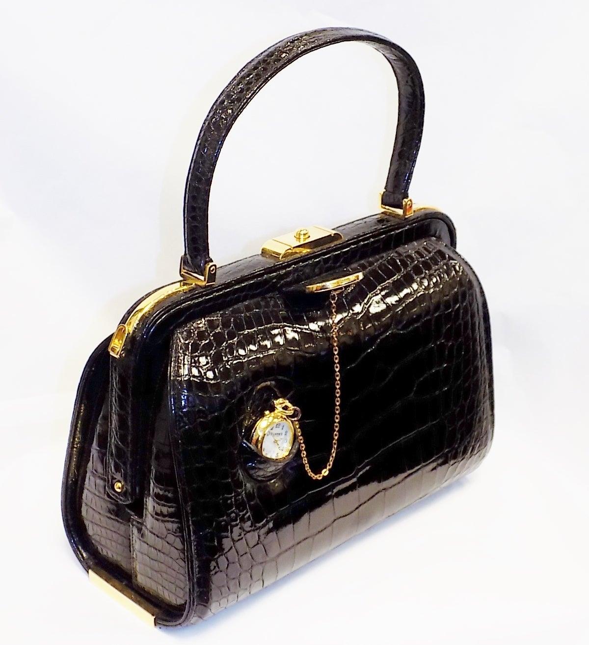 Suarez vintage alligator bag with pocket watch at 1stdibs