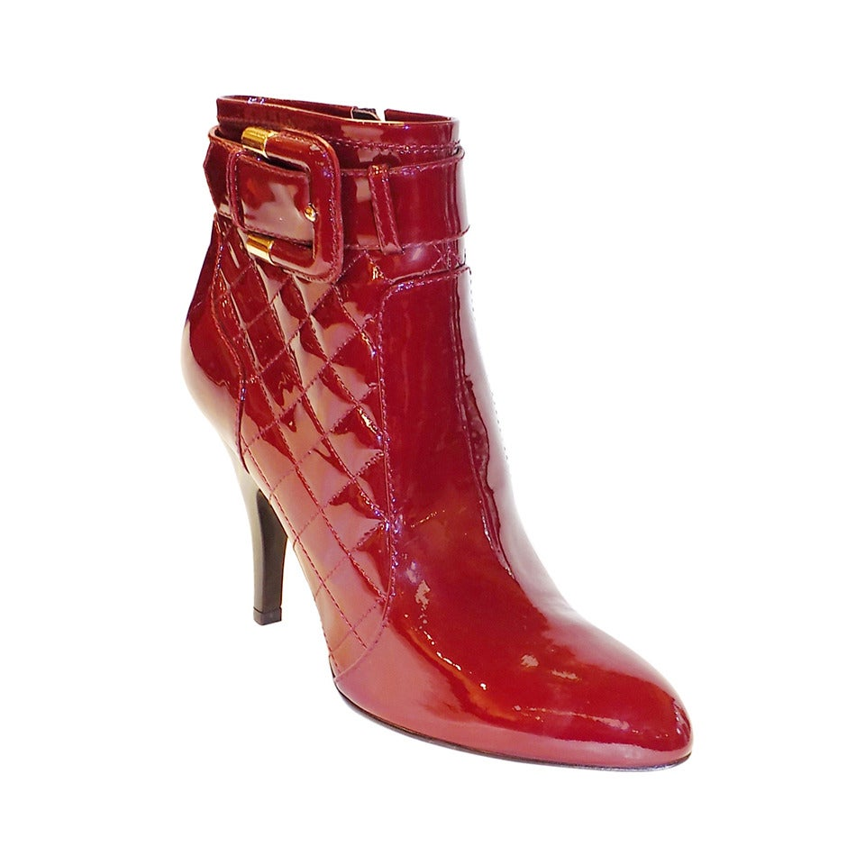 Gucci's red patent leather ankle boots are styled with a chunky block heel and embellished with an antiqued brasstone metal and glass imitation-pearl bee. First seen in the s, the gilded bee is a signature motif of the celebrated Italian house.