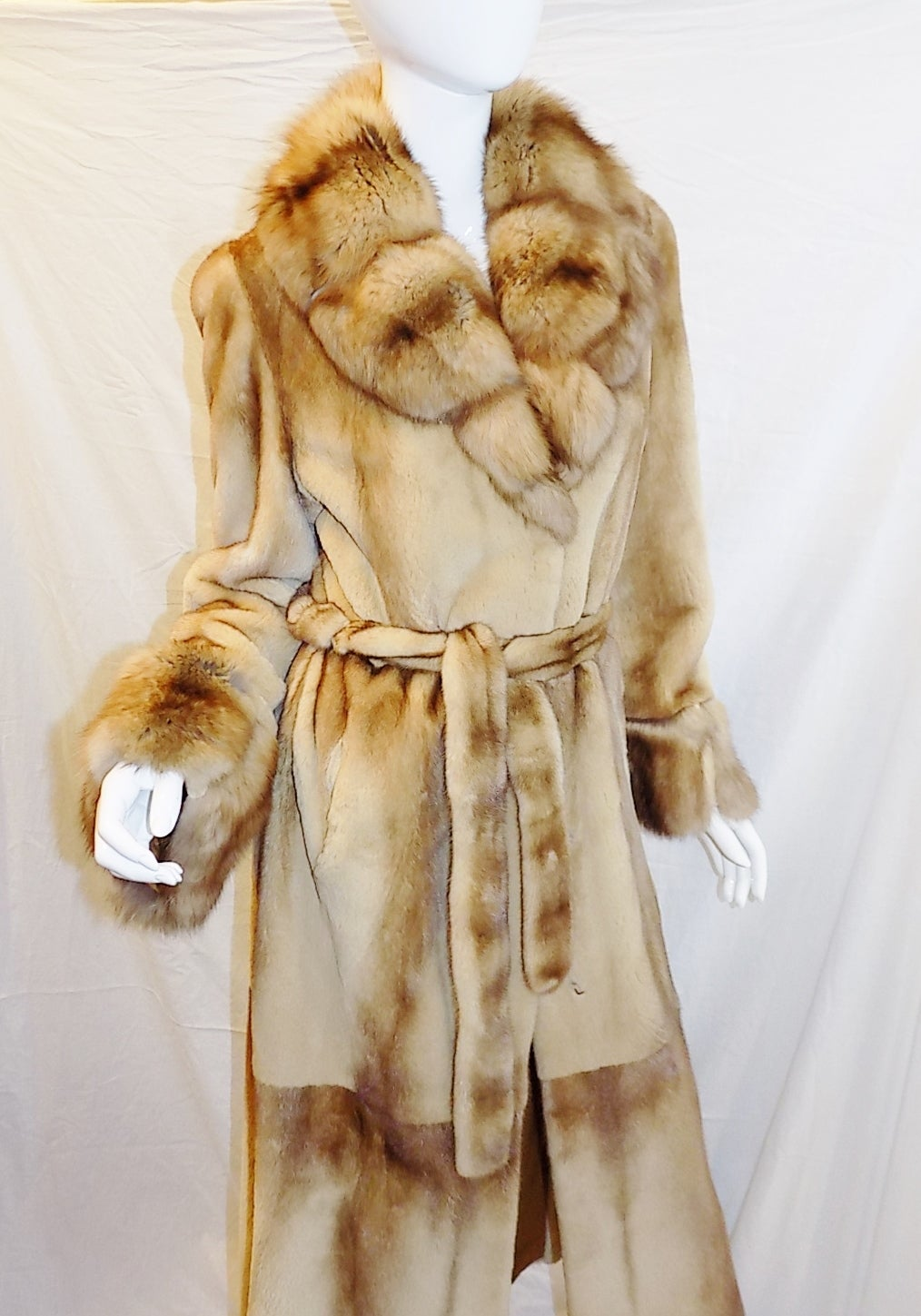 Insanely beautiful  honey ombre  sheared( from longer to shorter hair) female  mink with Russian large shawl collar and cuffs. Coat is last season custom made by Saga Furs Royal edition. Fully Lined in tabacco.. Front clips closure. Side slits.