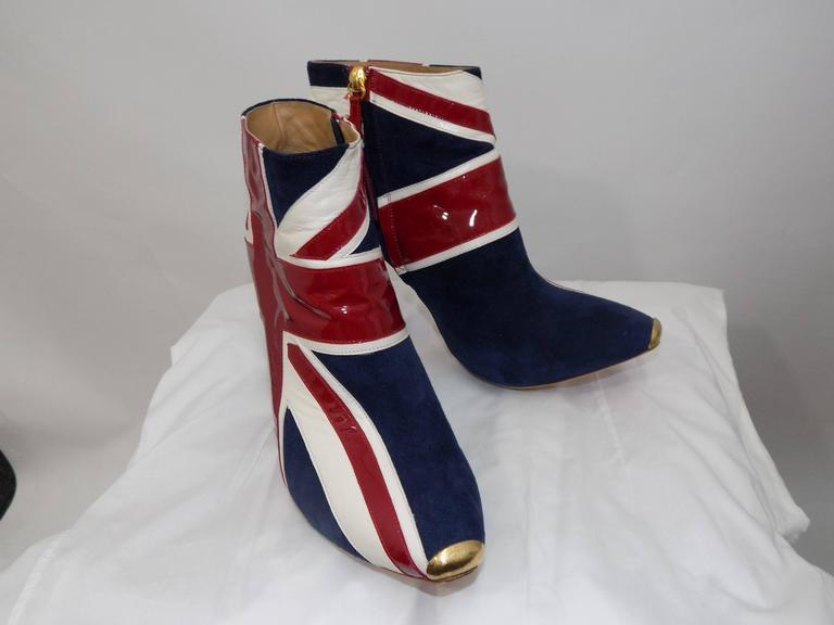 ALEXANDER MCQUEEN Union Jack ankle boots  Details Patriotic and very rock 'n' roll, wear these boots to give your look a modern punk vibe. Team them with a full skirt for a fun and flirtatious evening look.These beautiful Alexander McQueen ankle