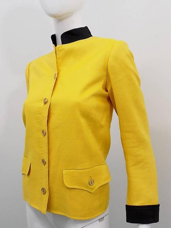 """Fabulous linen jacket. Fully lined. Military style . Black details collar and cuffs. Two front pockets Front button down closure wit YSL engraved buttons, Pristine condition. Size 34 Shoulders 14"""" bust 34"""" sleeves 23"""" length 23"""""""