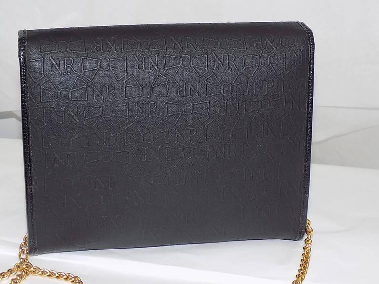 Nina Ricci black coated canvaswith gold chain bag / clutch 3