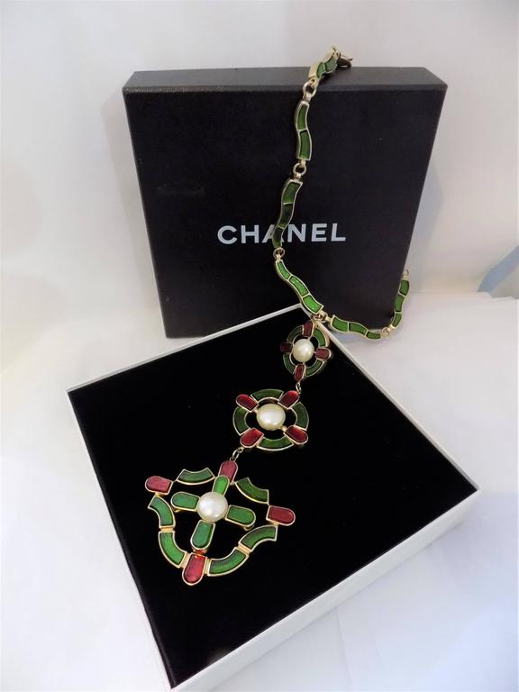 This is rare and important massive glamorous necklace from 2007 pre-fall CHANEL MONTE CARLO COLLECTION, and was featured  as  major RUNWAY SHOW piece. *** Waving with 3 Chanel signature colors Gripoix glass pendant. 3 different sized jumbo raised