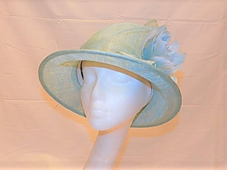 Spectacular baby blue summer hat. Beautiful design with foldings  , Clochete style . Silk flower and ultra fine horse hair side  details. One size fits all , Custom made by order from Couture Inc. House in Manhattan, NY