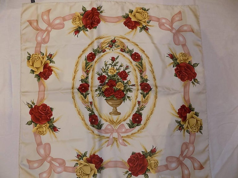 Beautiful Christian Dior Vintage silk floral scarf with pink ribbon and bow. Mint condition . Hand rolled edges.  35 by 35 Pink ,gold and deep red major colors
