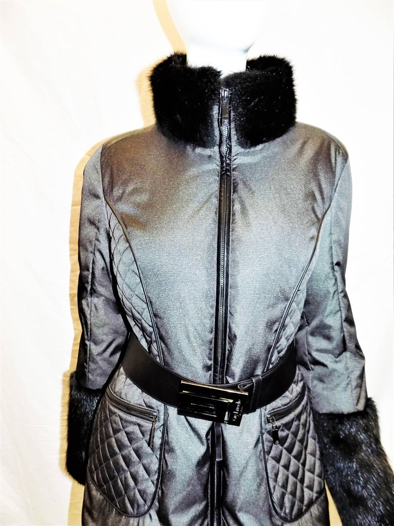 "New with tags retail price $2995 beautiful down coat by Guy Laroche for Maximillian. Sold out. Color is called ""dark green"" although appears black  with hint of metallic. Black Muskrat trim. Black leather details and belt with Laroche logo.  Bust"