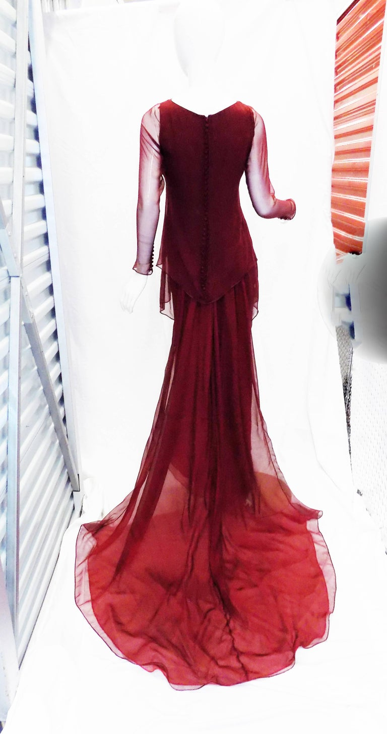 Spectacular Haute couture Chanel silk chiffon gown , Pristine condition. Very conservative look . Perfect for your jewellery display.  . Back of the dress is absolutely stunning. 50 small silk covered buttons and amazing train that could be worn on