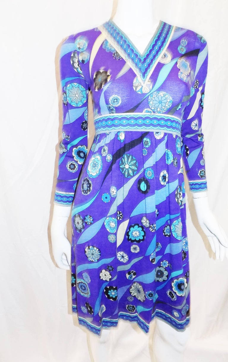 Beautiful vintage PUCCI blue print empire cut  wool and silk dress 1970. Very light blend of wool and silk in vivid blue tones and stunning print. Empire style. V neck collar. Zipper back and side closure. Pristine condition. Perfect fall, winter