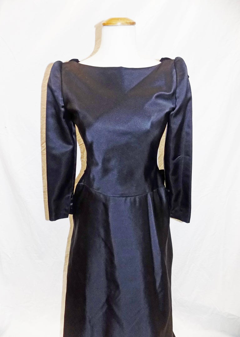 Spectacular vintage Oscar de la Renta  Black silk  satin duchess gown reminiscing 18 century. Gown features deep V back with wired