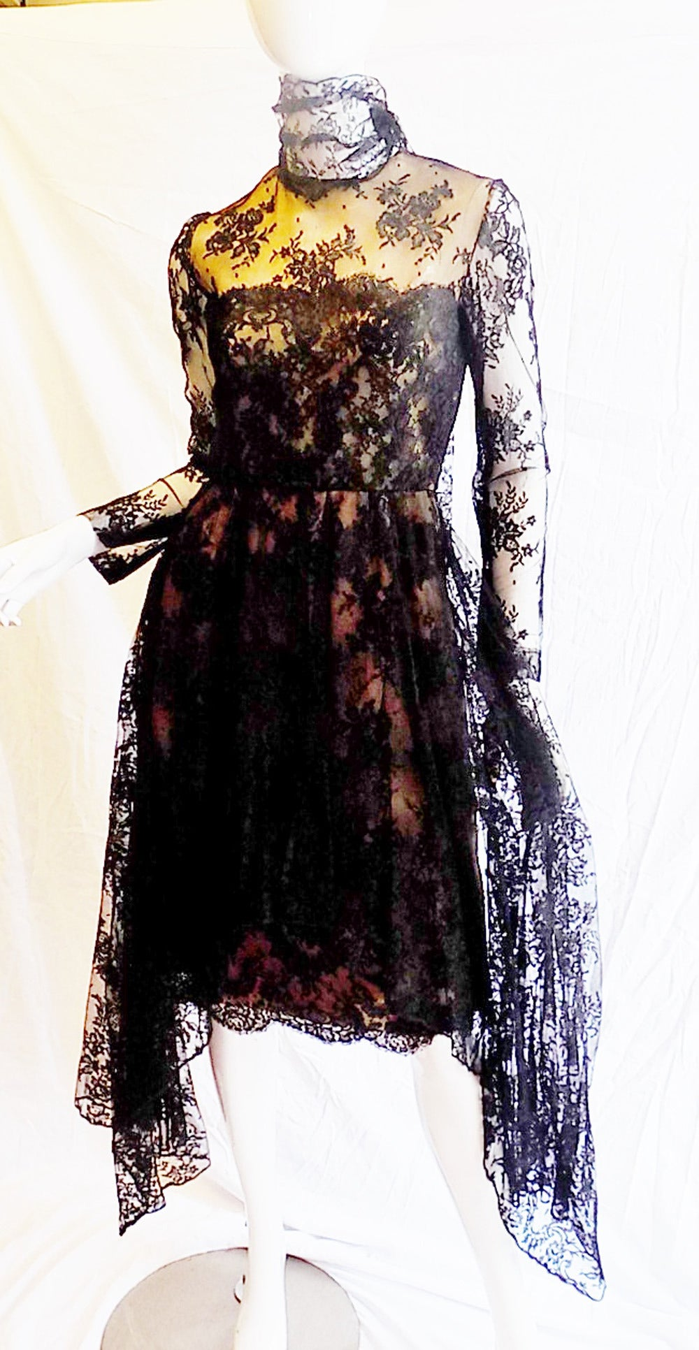 Worn once in Monaco in 1980!  Photo included. Truly spectacular and in pristine condition! Nude lining under black french scalloped edges lace. High- low over skirt. Long attached scarf. Every bit of this dress speaks   true elegance.  Dress is