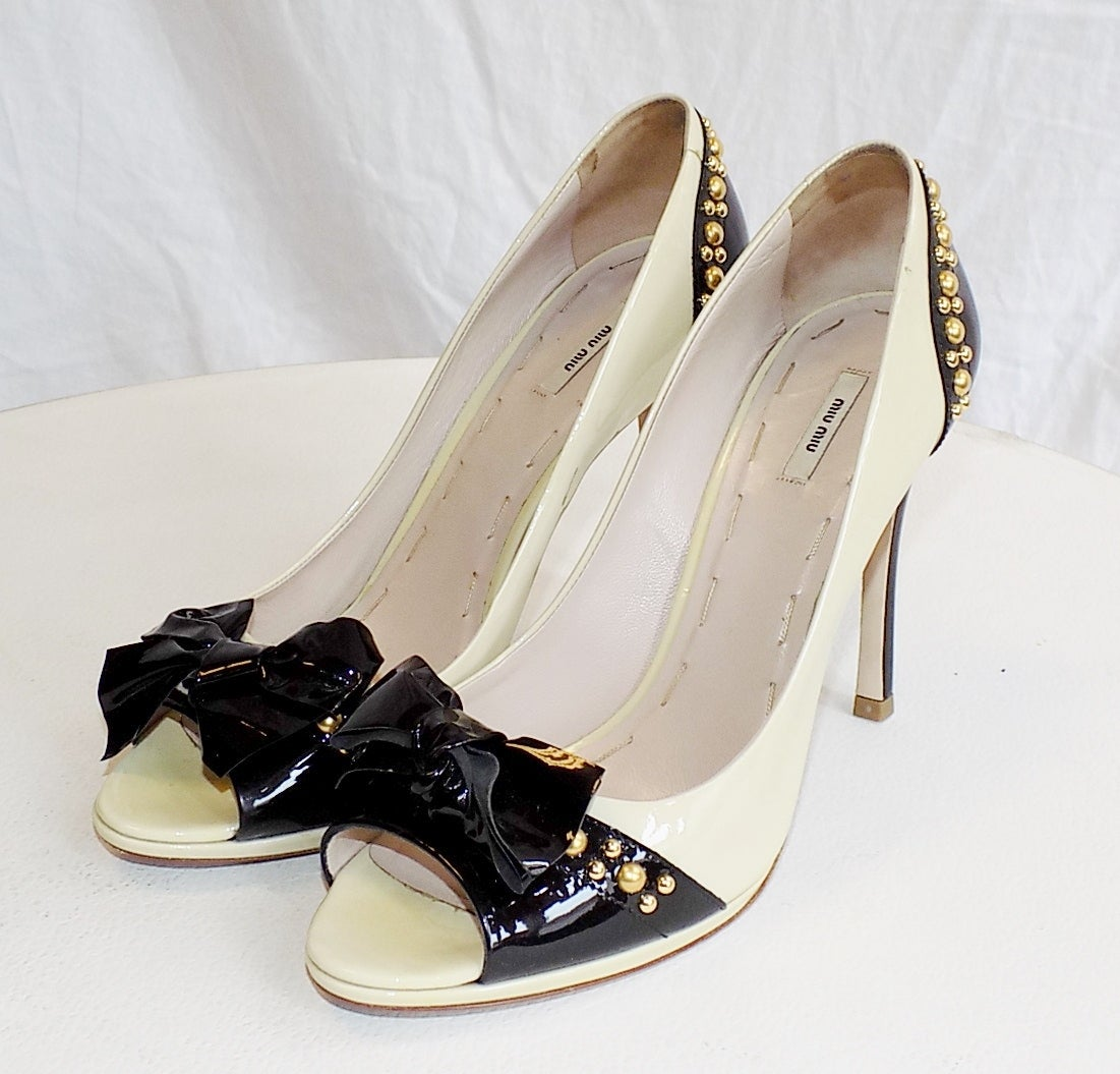 Worn once in pristine condition perfect summer Miu Miu Two Tone  patent leather open toe shoes with gold  Studs . Size 38. Heel 4.5
