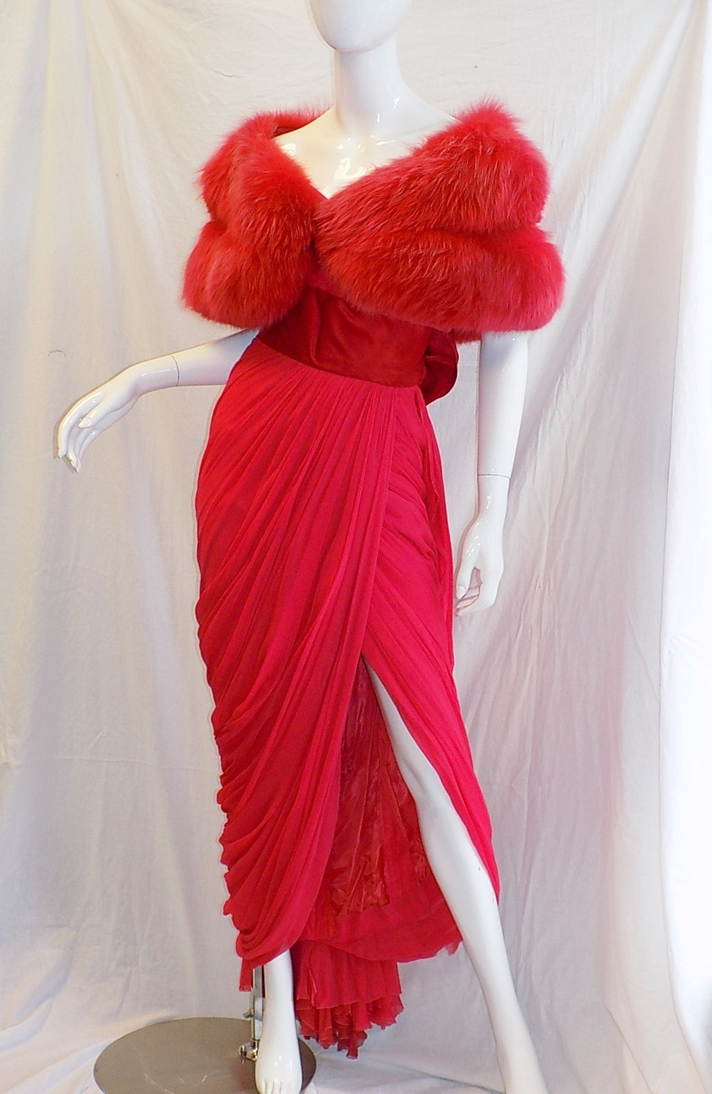 Breathtaking Jean Dessès red silk chiffon  gown. Spectacular draping featuring back bustle with two bows. Cherry on the top is pristine condition dyed fox to match red fur stole . Dress was well kept and  fur preserved. Immaculate condition with