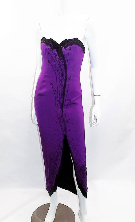 Circa 1980 In Pristine condition Never worn Fabulous Fabrice Gown.  Fully Boned Corset Strapless  Dress. Dark purple color with black  beading. Every bead is intact!! Look Glamorous!! Size Small