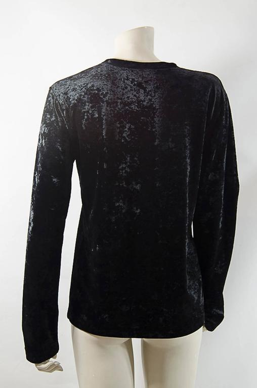 Black CRUSHED SOFT VELVET WITH LARGE BLACK CRYSTAL YSL LOGO . VERY RARE. STATES SIZE L  BUST 38 LENGHT 28 SLEEVES 26