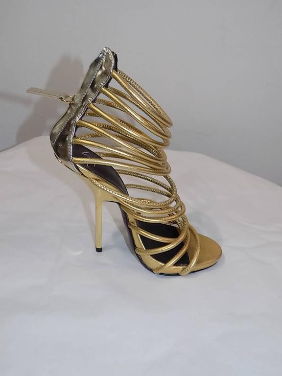 Giuseppe Zanotti Metallic Gold Strappy  Bangle Sandal  In New never worn Condition For Sale In New York, NY