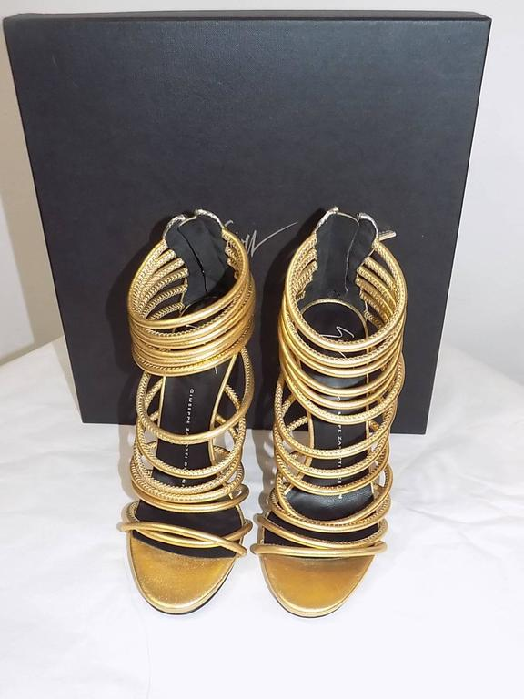 New in box Giuseppe Zanotti Metallic Gold Strappy  Bangle Sandal , Gold  with silver detail at the back and zipper. Size 5