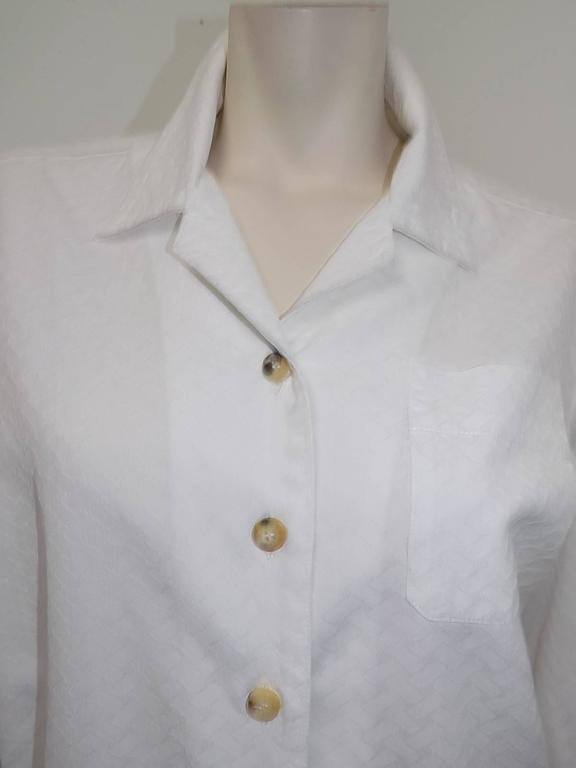 "Perfect 100% cotton  crepe Hermes white  shirt . Crisp and fabulous featuring one top pocket, folded  cuffs, collar , back fold and beautiful horn buttons that are engraved "" Hermes"" Size 42 bust 46"" length 27"" sleeves 23"""