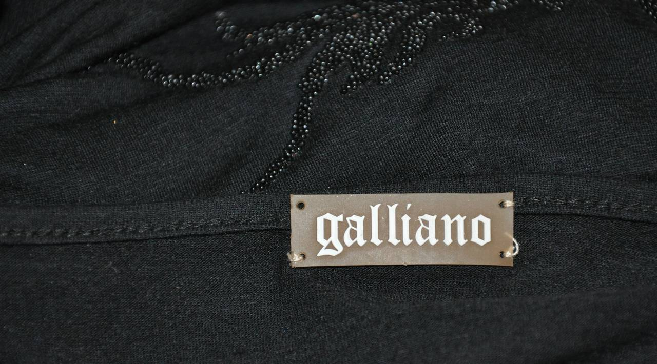 "John Galliano ""Asian"" inspired black scoop neck front top in a wool-cotton blend jersey measures 18"" across the shoulders. Underarm circumference measures 38"", underarm to hem is 19"", total length is 26"", waist is 32"", hips are 44"", sleeve is 25"","