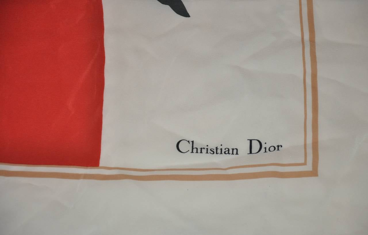 """Christian Dior silk scarf of """"Tulips"""" is finished with hand-rolled edges. The silk scarf measures 33"""" x 34""""."""