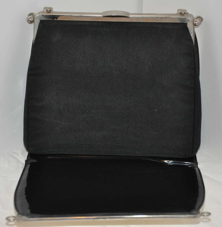 "This wonderfully rare ""3-In-1"" Confetti handbag has two additional handbag covers for quick changes. Choice of ""Confetti"", ""Black patent leather"", and ""Black ribbon silk"" are your choices. Simply snap off all four silver hardware corners, flip, snap"