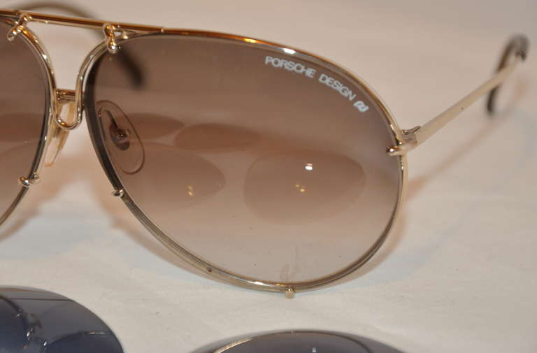 """Porsches Design """"Carera"""" Racer frames are finished with 18k yellow gold. Just flip the center front top, with a choice of two other lenses. Comes with original case and lens cover. tips are finished with smoked-gray lucite.    Frames measures 5"""