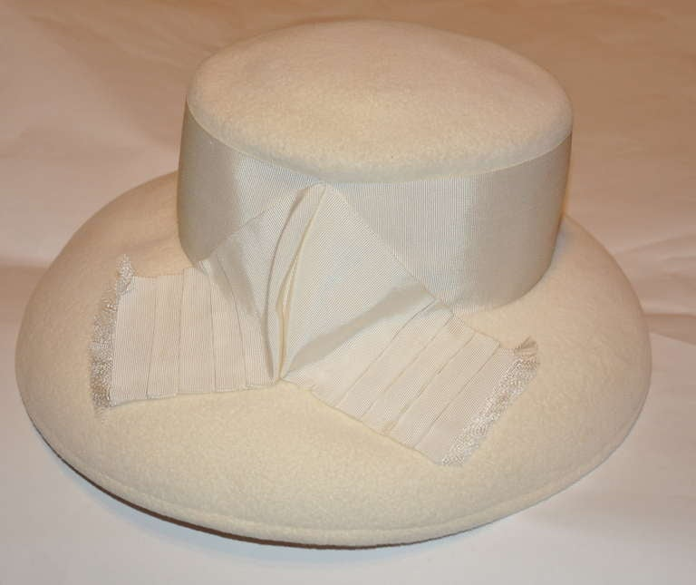 Halston's wonderful ivory wool felt hat is accented with a wide 3
