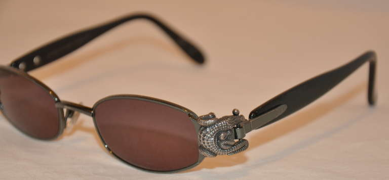92c0cb5c885 Kieselstein-Cord Signature crocodile accents these wonderful sunglasses.  Frames are in black hardware and