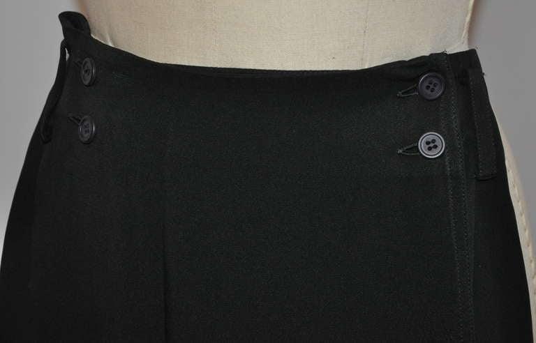 This wonderful OZBEK asymmetrical black wrap-around skirt measures 14