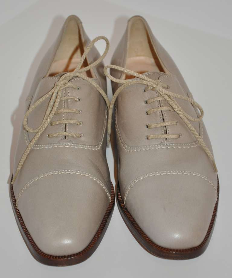 "This wonderfully classic lace-up women's shoe is all hand-made with lambskin upper and calf-skin soles. Color is a pale-taupe with heels measuring 1 1/8"", size 8.5 Italy, 8 1/2 American medium width."