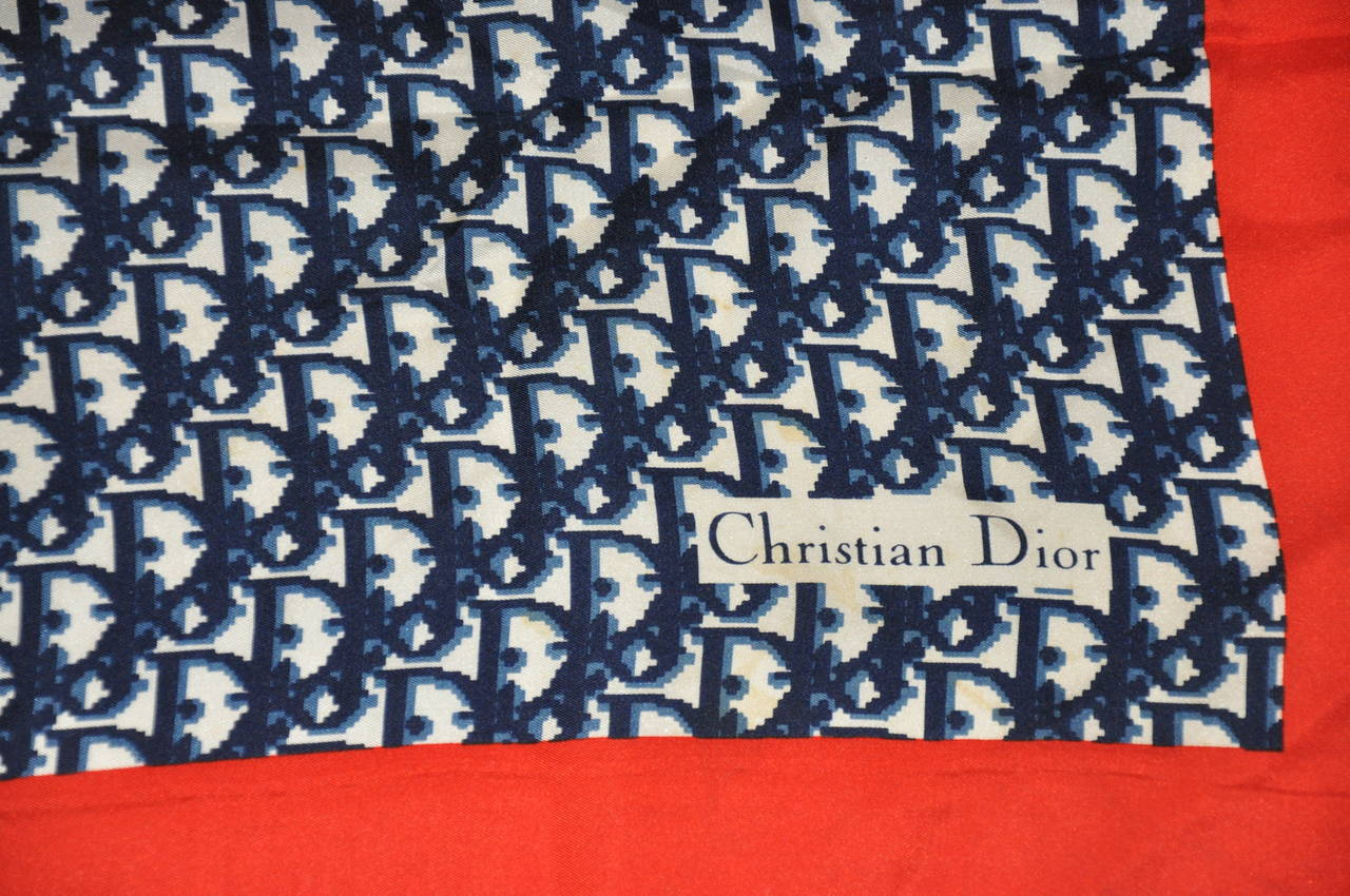 Christian Dior's signature red, white and blue monogram silk scarf measures 30