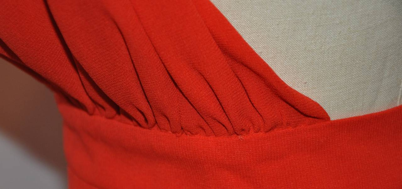 """Halston's signature double-layered red crepe halter button top has a single button located on the back of the neck. The waist measures 27"""", waistband width is 1 1/2"""", neck-to-waist length is 20"""". The total length on back measures 8 3/4"""","""