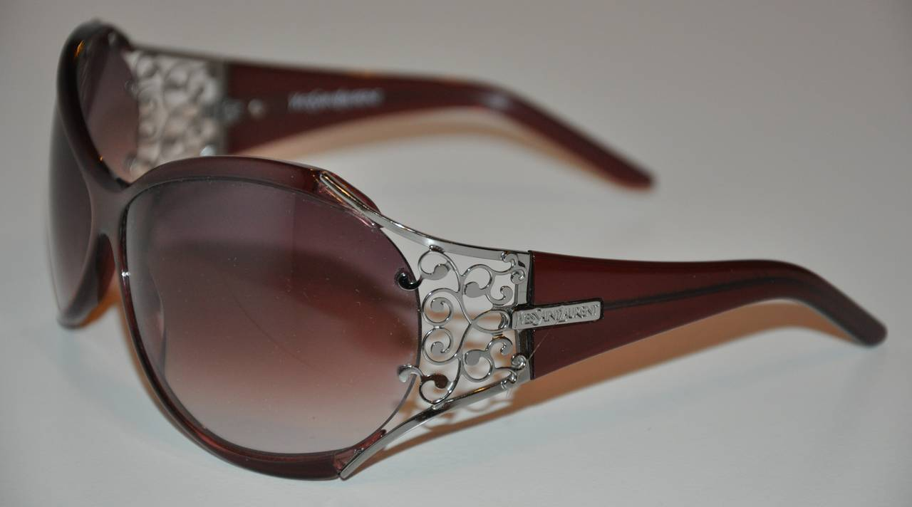 These wicked Yves Saint Laurent Lucite sunglasses in a wonderful violet shade is detailed with silver hardware