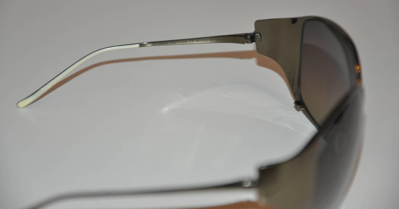 f6fd3ea516 Items Similar to Christian Roth Steel-Gray Titanium Semi-Wrap Sunglasses  View More. HomeFashionAccessoriesSunglasses. null. null. null. null