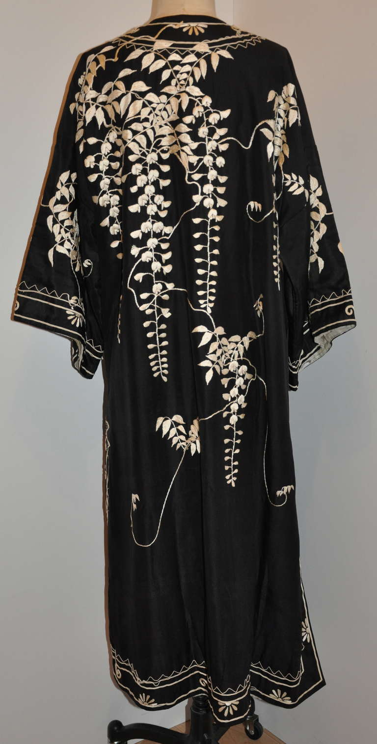 This wonderfully detailed kimono of floral with branches and leaves is softly quited for those chilly months. Hand-embroidered throughout with borders finished with micro silk cord of cream color.