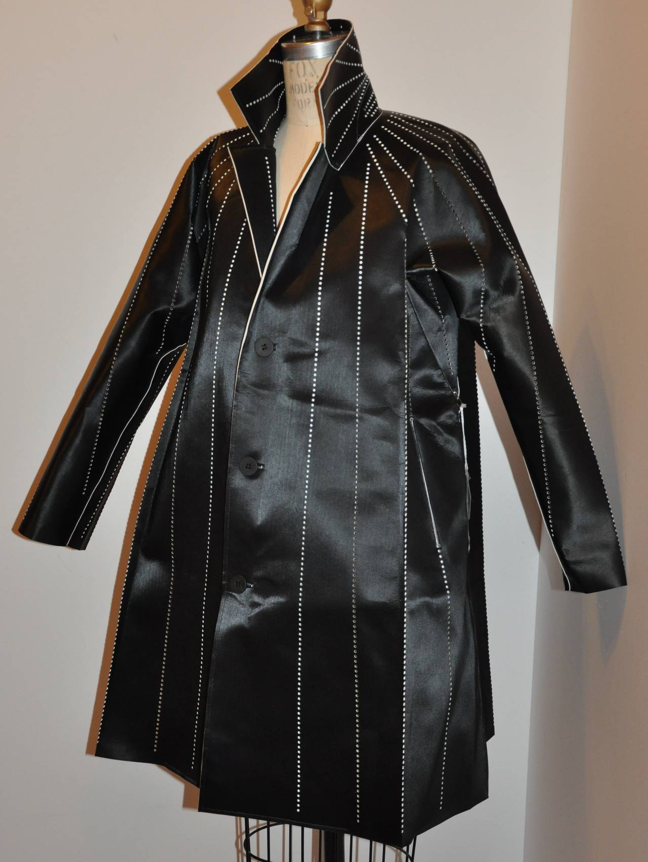 """Issey Miyake Whimsical dark navy stencil flared jacket measures 35 1/2"""" in total length. Underarm circumference measures 43"""", collar stands at 4"""" in width, sleeves are 27"""", cuff circumference is 10 1/2"""". The hem's circumference measures 66"""". The"""