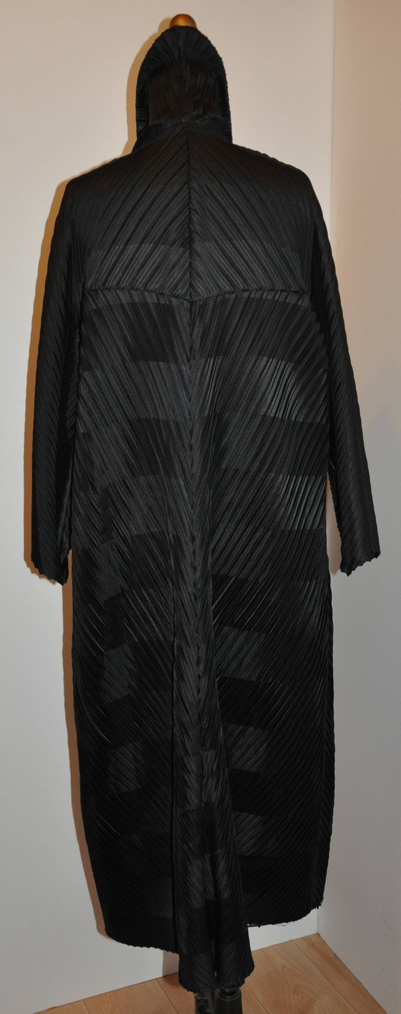 Issey Miyake signature pleated medium-weight multi-directional button coat measures 47