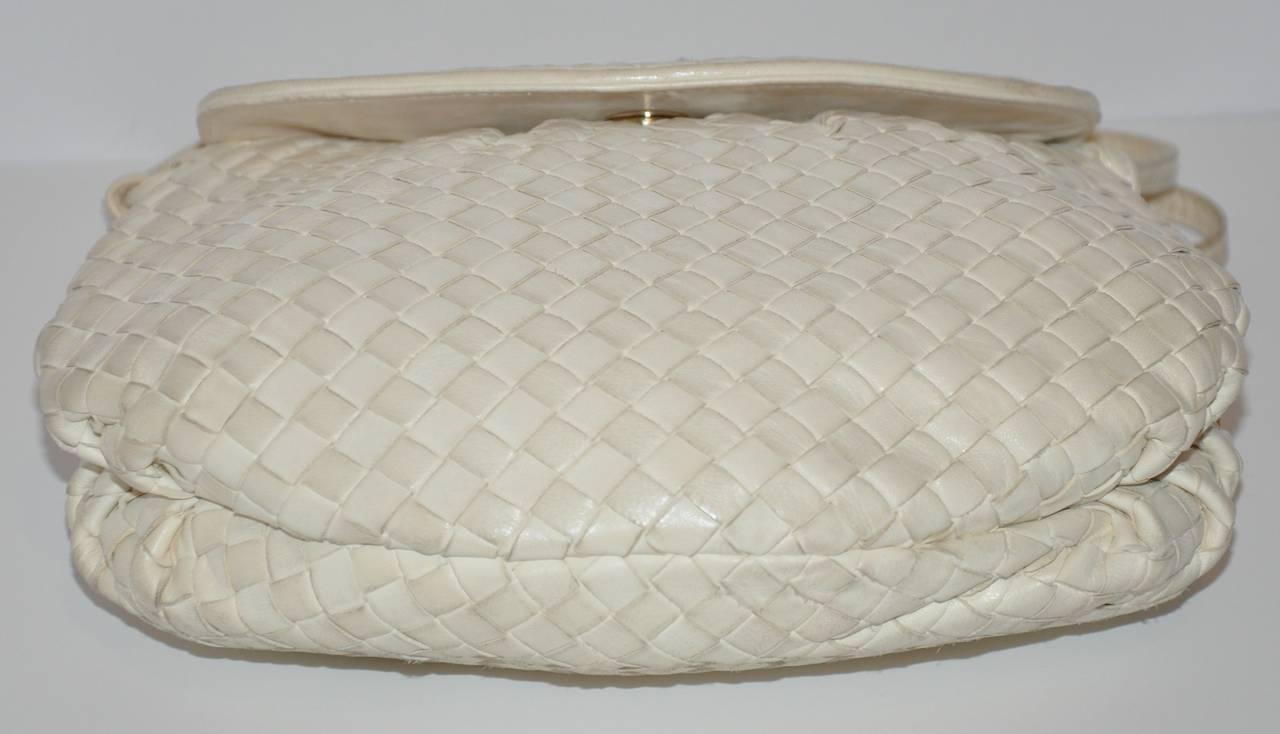 Bottega Veneta cream signature lambskin woven shoulder bag measures 8